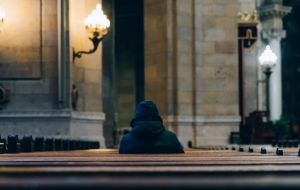 person-sitting-inside-church-2539077