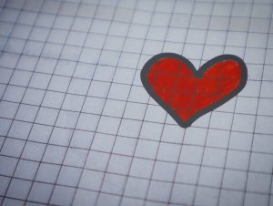 white-page-of-graphing-paper-with-red-heart-drawing-920938