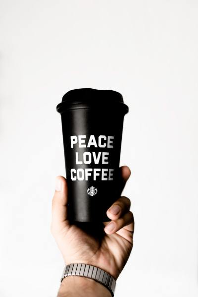 person-holding-starbucks-coffee-tumbler-2744760