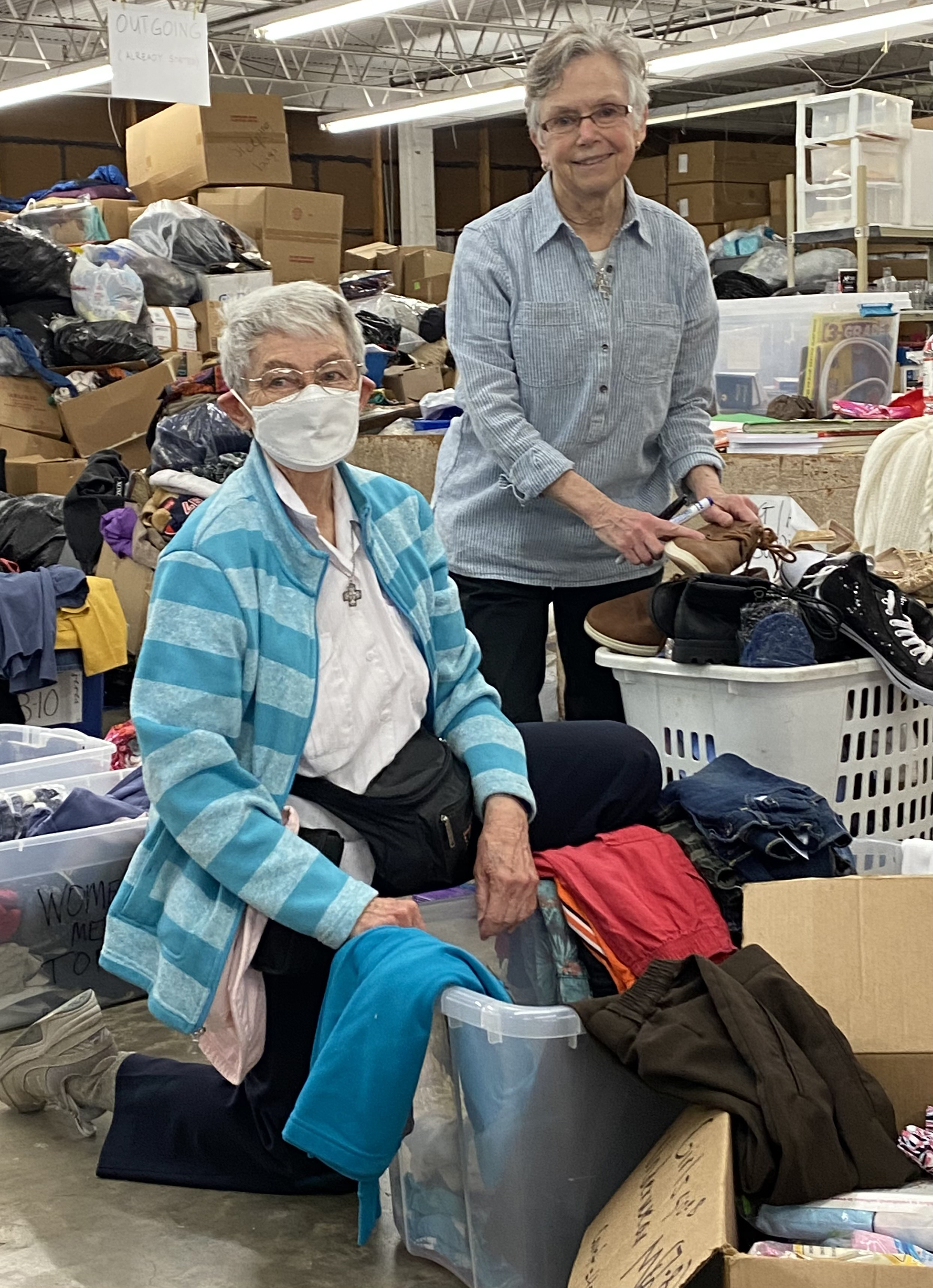 Mary Pung and Rita Ann.Sorting Clothes